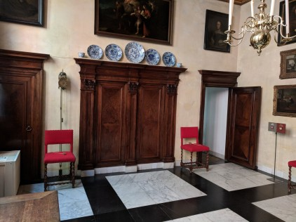The Dutch value symmetry so much that this room has two doors, one o each side of the fireplace. The catch is that one of the doors led nowhere: It's soul purpose was to complete the symmetry of the room.
