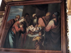 Painting of Saint Nicolas dropping a bag of coins into a house with three daughters to help their father pay for a dowry for them so they wouldn't have to go into prostitution.