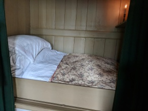 Dutch box bed, used in many houses. You would sleep sitting up to save space.