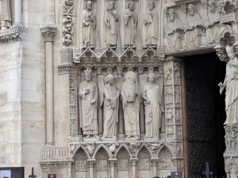 Notice the guy holding his head? St. Denis.