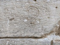 These are signatures found in the stones of the original mote around the fortress