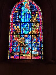 This stained glass window, unlike so many ancient windows we have photographed, was added after World War II to honor the paratroopers who liberated