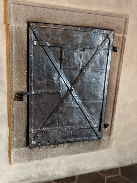 The furnace on the other side of this door was fed by servants so the king and his guests didn't have to be bothered with it.