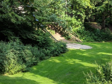 This part of the moat is now a park with a slide going down the side of the hill.