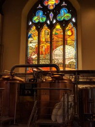 Stained glass depicting the growing of the barley
