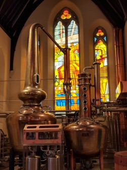 Stained glass depicting the distillation process