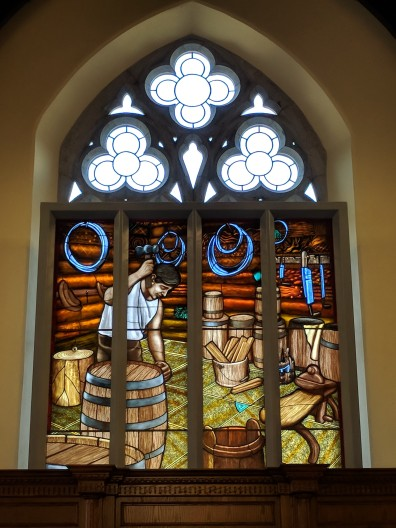 Stained glass depicting the fermenting of the barley into beer