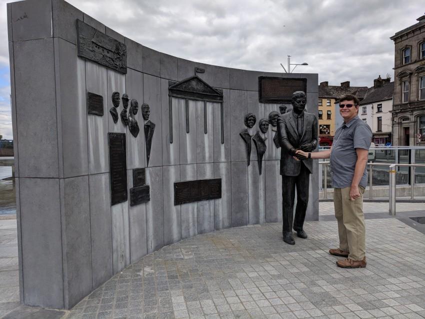 Shaking hands with John F. Kennedy, grandchild of Irish immigrants
