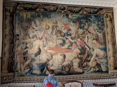 The walls were lined with huge tapestries, each telling part of a story