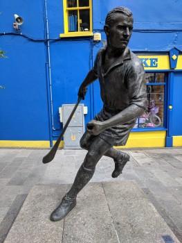 Hurling, an Irish sport using a hockey-like stick...It looks like a cross between baseball and hockey.