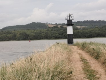 The island required a lighthouse so incoming ships would realize the river was divided there.